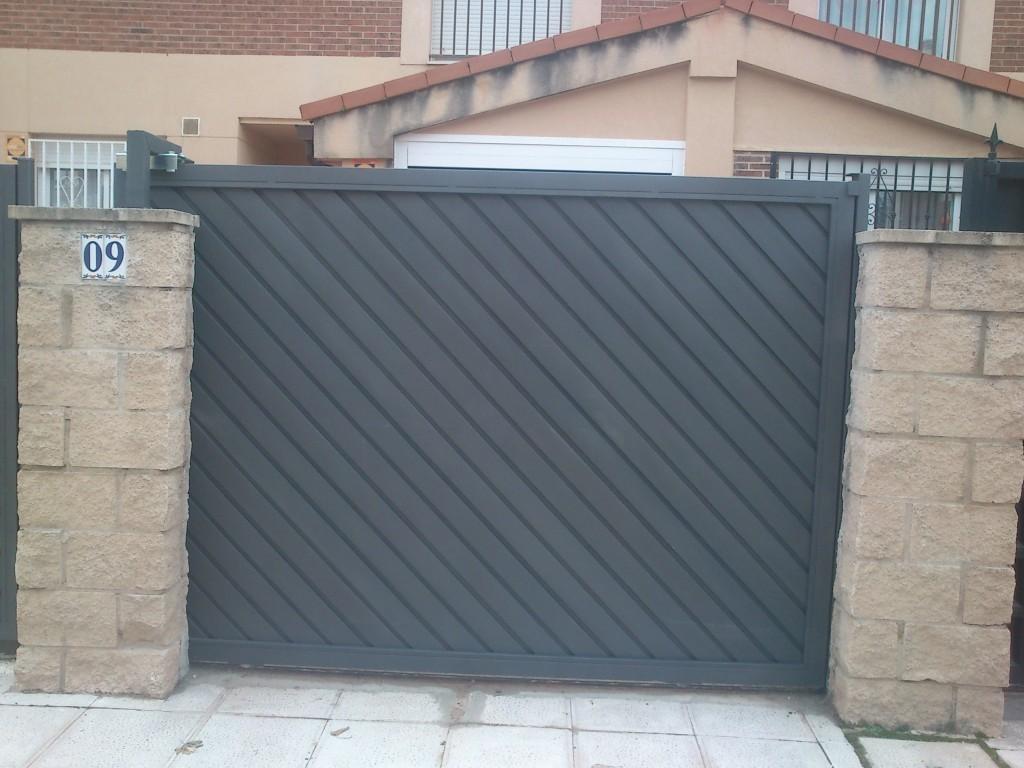 Puertas correderas madrid autom ticas garajes guadalajara for Puertas automaticas garaje